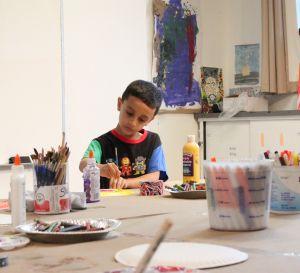 boy making art project at pelham art center class